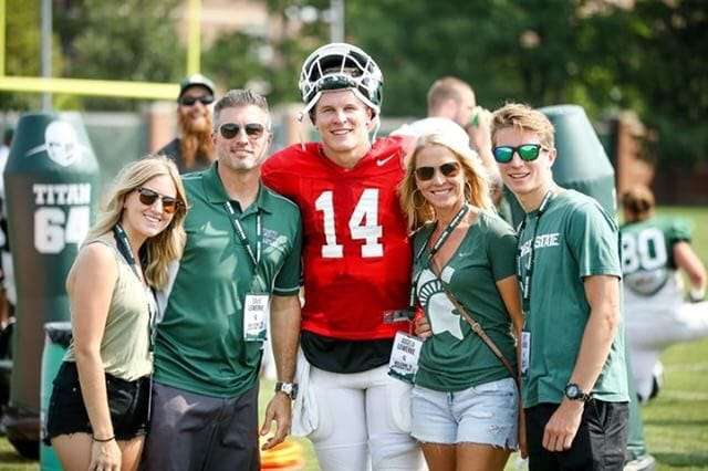 MSU QB Brian Lewerke poses with his family at a practice. From left to right: his sister, Courteney, father, David, mother, Angela and brother, Brett.
