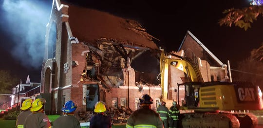 A church fire at Wesley United Methodist Church on Sunday as local fire crews battled the flames into the night.