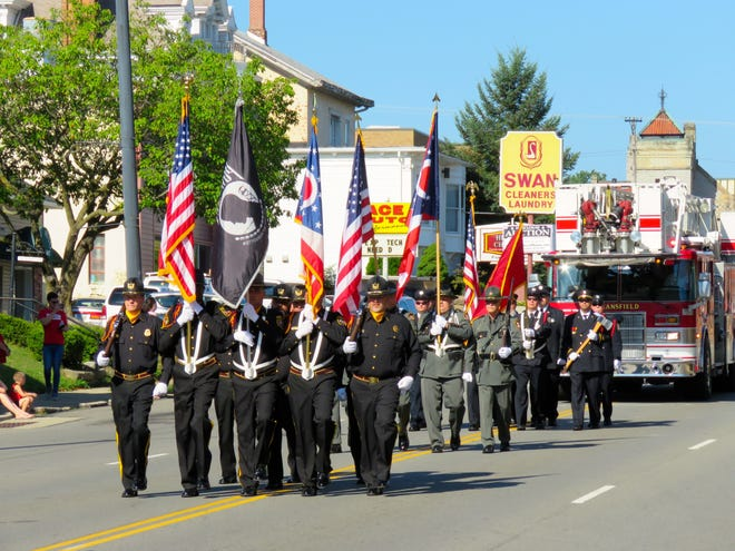 A joint color guard representing the Richland County Sheriff's Office, Mansfield Correctional Institution and the IAFF Local 266 lead the 2018 Labor Day Parade.