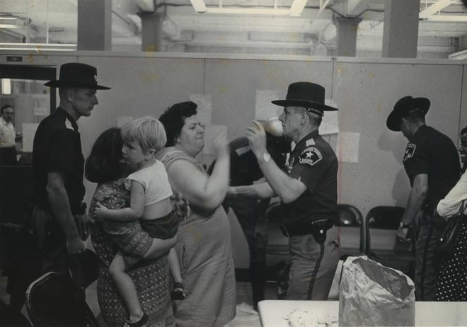 Welfare recipients clash with Milwaukee County sheriff's deputies in the welfare department office on Sept. 4, 1968. Nine women, some carrying children, and a man in a wheelchair were arrested after staging a protest for higher payments for clothing and basic needs. This photo was published in the Sept. 5, 1968, Milwaukee Sentinel.