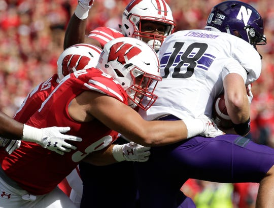 Wisconsin defensive end Isaiahh Loudermilk sacks Northwestern quarterback Clayton Thorson.