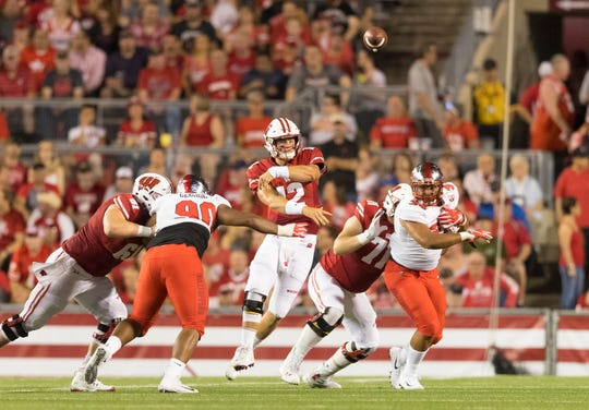 Cole Van Lanen (71) protects UW quarterback Alex Hornibrook during the second quarter Friday night against Western Kentucky.