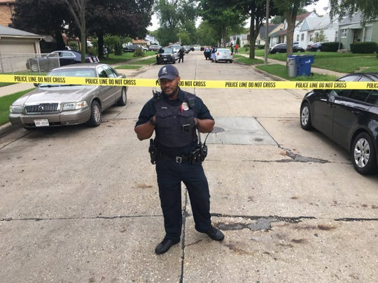 A Milwaukee police officer patrols the scene in the 4800 block of N. 62nd St. where a 3-year-old was abducted from her home at gunpoint early Monday.