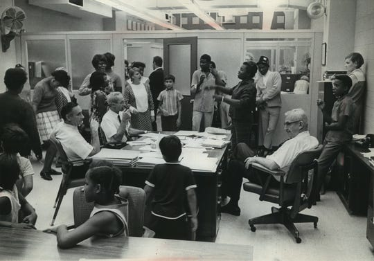 Protesters march into the office of Milwaukee County welfare director Joseph E. Baldwin (right, seated) on Sept. 4, 1968, to complain that welfare benefits being paid by the county didn't meet basic needs. Ten demonstrators, including a man in a wheelchair, were later arrested. This photo was published in the Sept. 5, 1968, Milwaukee Sentinel.