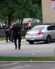 A police officer holds Phoenix Dickens after the 3-year-old girl was found. She had been abducted early Monday.