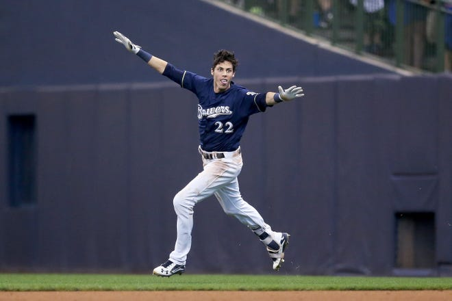 Christian Yelich celebrates after knocking in the winning run Monday at Miller Park.