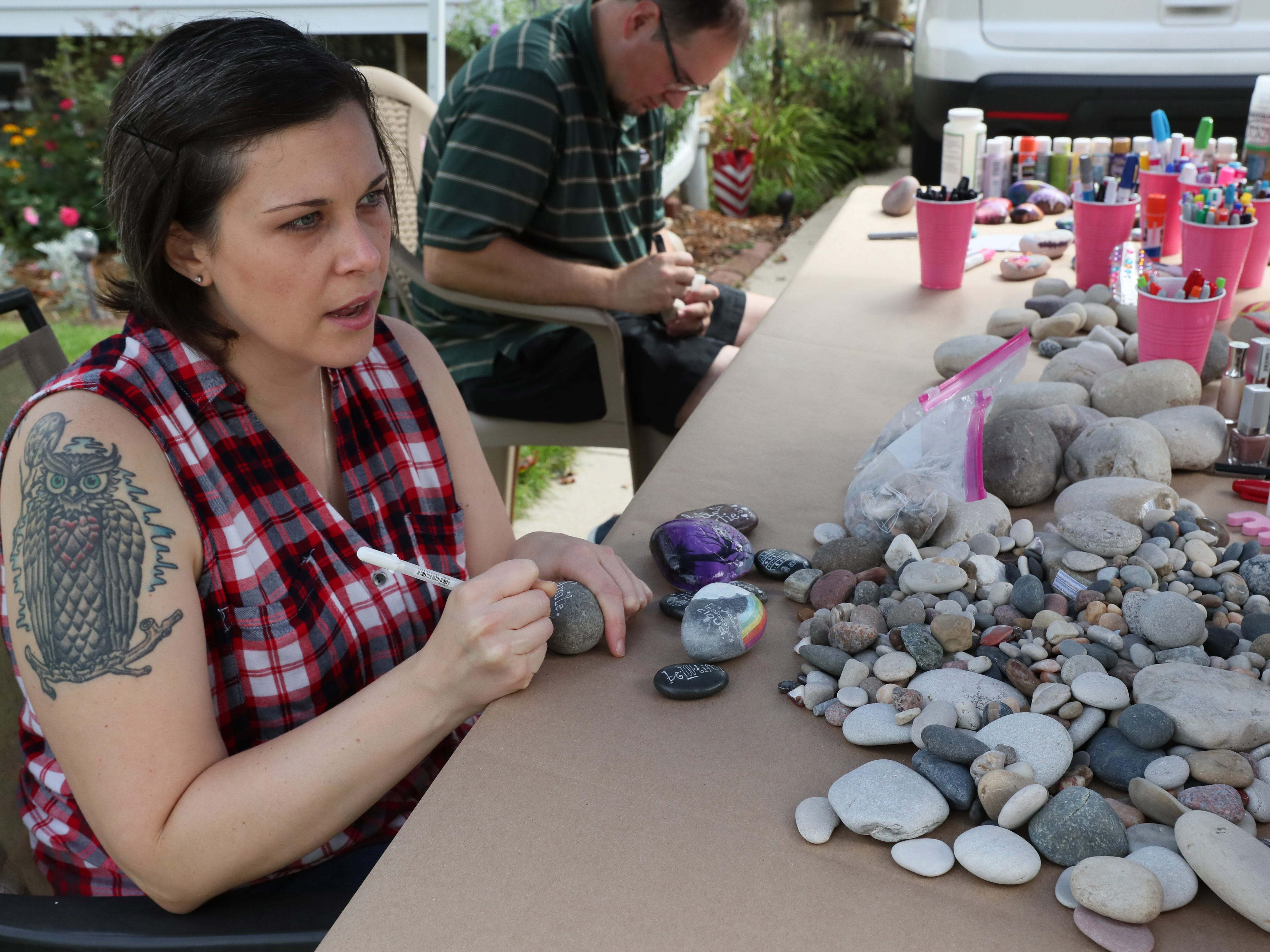 Crystal Zagorski and her husband Sam Zagorski add inspirational messages to rocks that WI Rocks will place around neighborhoods for people to find.