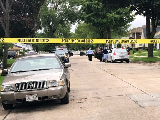Police tape surrounds an area in the 4800 block of N. 62nd St. in Milwaukee where a 3-year-old child was taken at gunpoint from her home early Monday