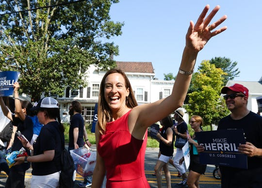 Congress candidate Mikie Sherill waves during the Mendham Labor Day Parade on September 3, 2018.    Alexandra Pais/ The Daily Record
