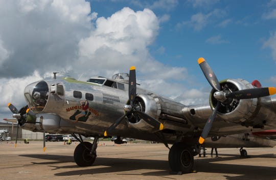 A Boeing B-17 bomber plane lands at the Montgomery Regional Airport in Montgomery, Ala., on Monday, Sept. 3, 2018.