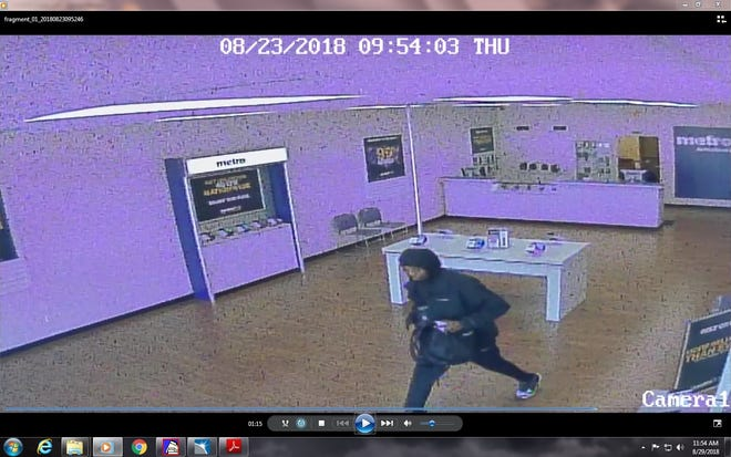 Muncie police have released this surveillance photo of a bandit who held up employees at the MetroPCS store in a southside shopping center on Aug. 23.