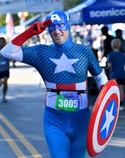 Mark Pierret dressed as Captain America runs the 40th Franklin Classic 5k Race Monday, Sept. 3, 2018, in Franklin, Tenn.