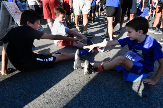Carter Greene, Derby Jones and Charlie Greene stretch before the 40th Franklin Classic 5k Race. Williamson County ranks as the healthiest — and wealthiest — county in the state.