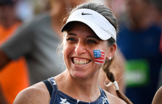 Amy Bratcher smiles before the 40th Franklin Classic 10k Race Monday, Sept. 3, 2018, in Franklin, Tenn.