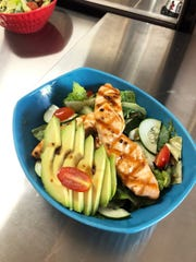 A grilled salmon salad at Western Prime Burger, which recently launched at Mission Square on Pine Ridge Road in North Naples.