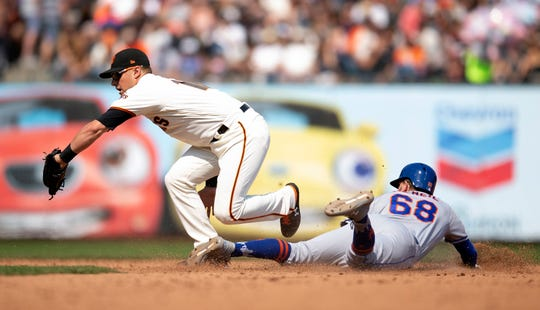 Sep 2, 2018; San Francisco, CA, USA; New York Mets Jeff McNeil (68) slides safely into second base with a steal as San Francisco Giants second baseman Joe Panik (12) takes the tardy relay during the eighth inning at AT&T Park.