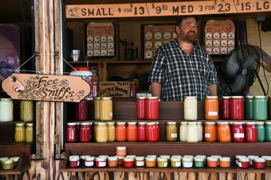 "The 43rd annual Rutherford Labor Day Street Fair took place along Park Ave. in downtown Rutherford on Monday, September 3, 2018. Ken Ingalls owner of Little House Candles offers ""Free Sniffs,"" of his scented candles at his booth on Park Ave."