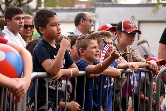 The 43rd annual Rutherford Labor Day Street Fair took place along Park Ave. in downtown Rutherford on Monday, September 3, 2018. A group of boys cheer on wrestlers Adam Payne and Beefcake Charlie during their match on Ames Ave.