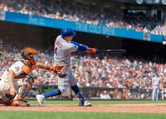 Sep 1, 2018; San Francisco, CA, USA; New York Mets second baseman Wilmer Flores (4) doubles during the eleventh inning against the San Francisco Giants at AT&T Park.