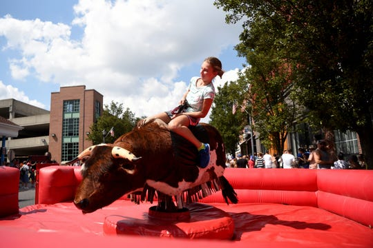The 43rd annual Rutherford Labor Day Street Fair took place along Park Ave. in downtown Rutherford on Monday, September 3, 2018. Sophia Klecha 10, of Pequannock Twp. rides a bucking mechanical bull.