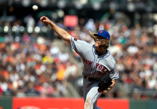 Sep 2, 2018; San Francisco, CA, USA; New York Mets starting pitcher Noah Syndergaard (34) throws the ball against the San Francisco Giants during the eighth inning at AT&T Park.