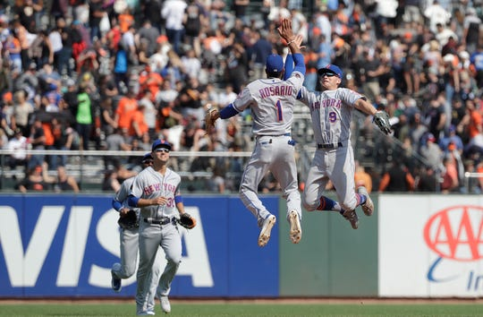 New York Mets' Amed Rosario (1) and Brandon Nimmo (9) celebrate after the Mets beat the San Francisco Giants in a baseball game in San Francisco, Sunday, Sept. 2, 2018. The Mets won 4-1.