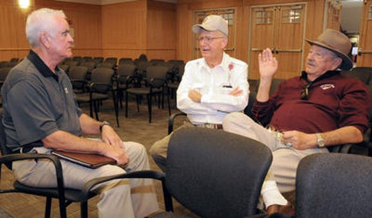 Larry Fields, of El Paso, Texas, left, speaks with Charlie Crowder, center, and Orlando Cervantes, both of Santa Teresa, N.M., on Oct. 24, 2012, at the conclusion of a public auction at the Doña Ana County Government Center in Las Cruces. The Santa Teresa Country Club, which Crowder and a partner developed, and its two golf courses were up for auction after the current owner fell behind on taxes. But no bidders were interested that day. Crowder died Aug. 7, 2018.