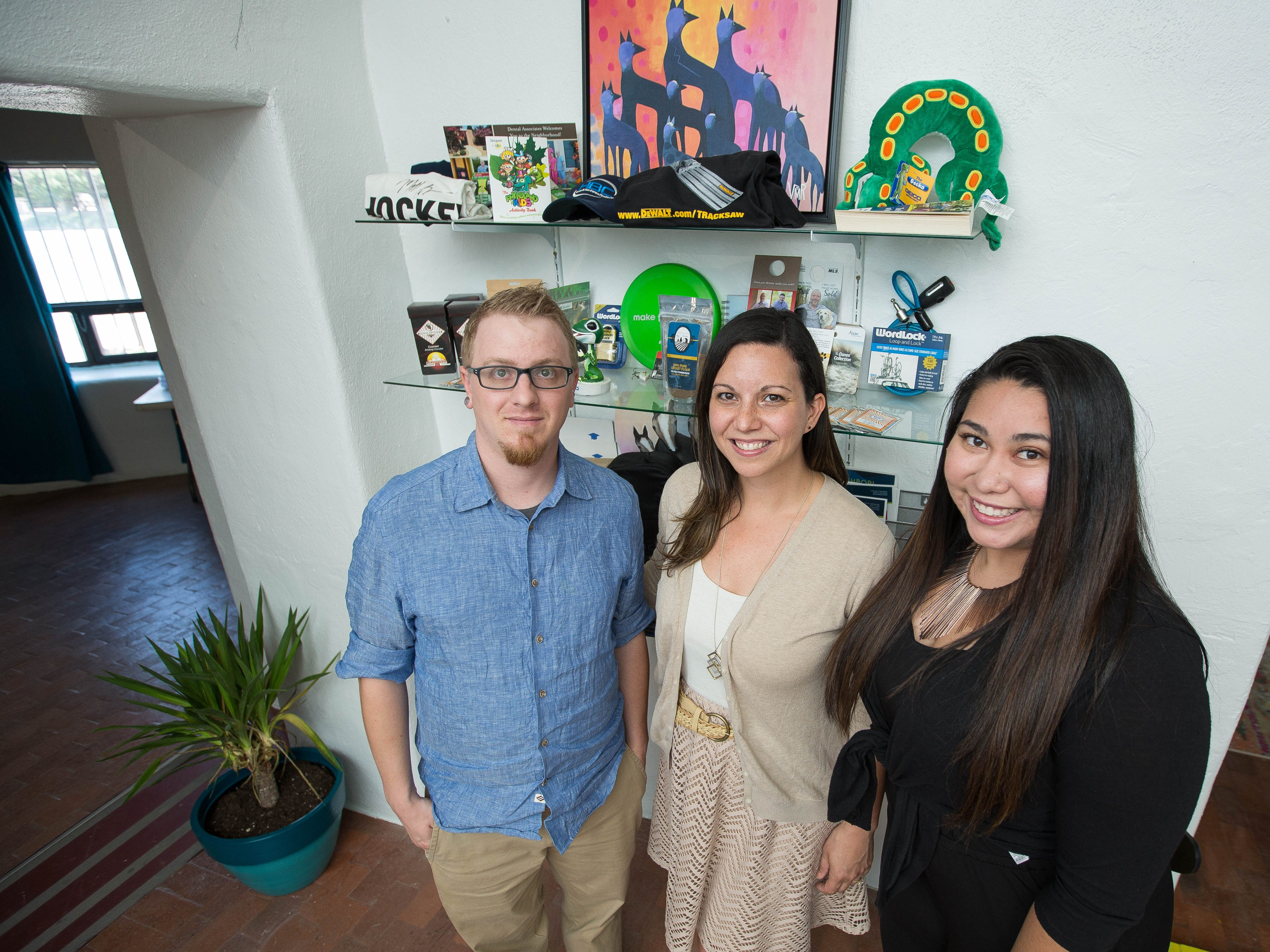 Joe Sutton, left, account executive with Sinuate Media; Leah Messina, center, CEO of Sinuate Media; and Isabella Pedicone, marketing manager for Sinuate Media; show off their new offices in Mesilla on Friday, Aug. 31, 2018.