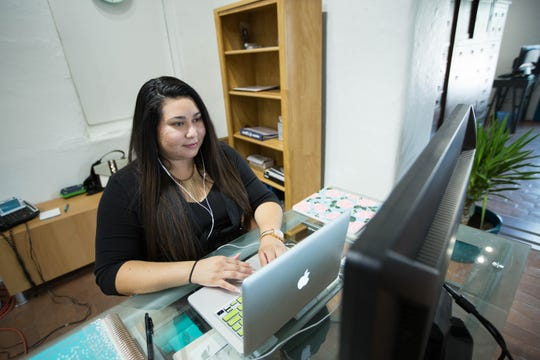 Isabella Pedicone, marketing manager for Sinuate Media, works in the marketing firm's new offices in Mesilla on Friday, Aug. 31, 2018.