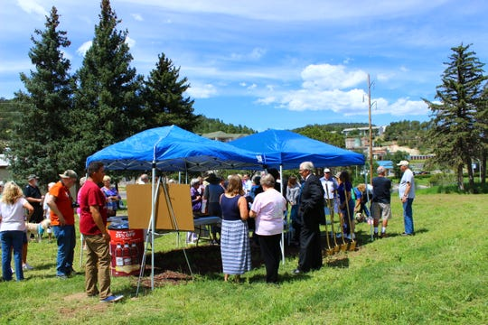 Guests and donors at ground breaking ceremony for new shelter that will be located on Highway 70 behind Sales for Tails.