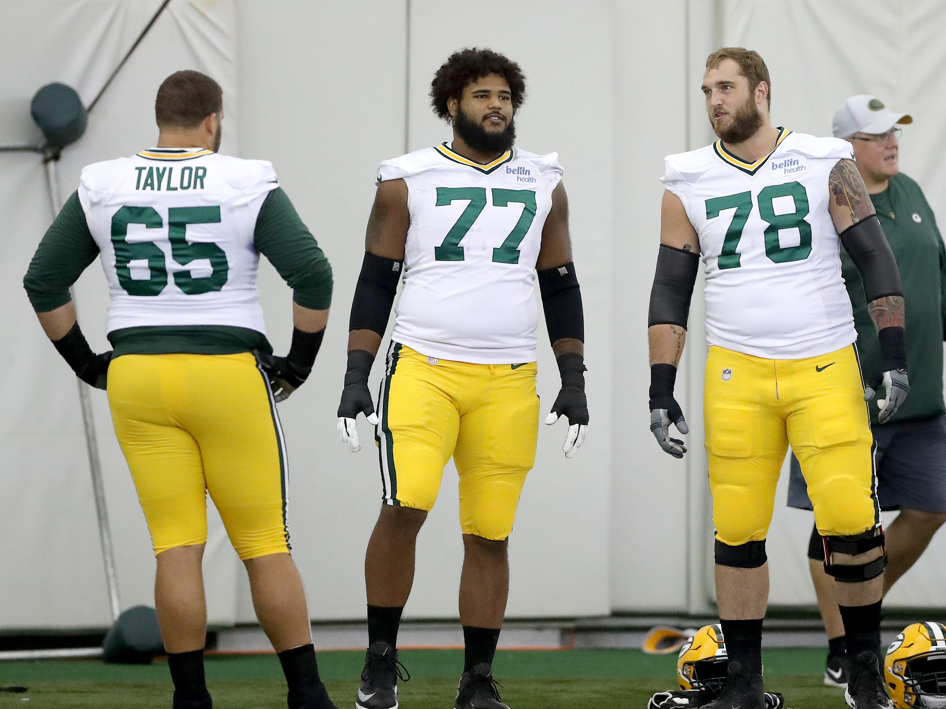 Green Bay Packers offensive guard Lane Taylor (65), / and offensive tackle Jason Spriggs (78) talk before Packers practice in the Don Hutson Center Monday, September 3, 2018 in Ashwaubenon, Wis
