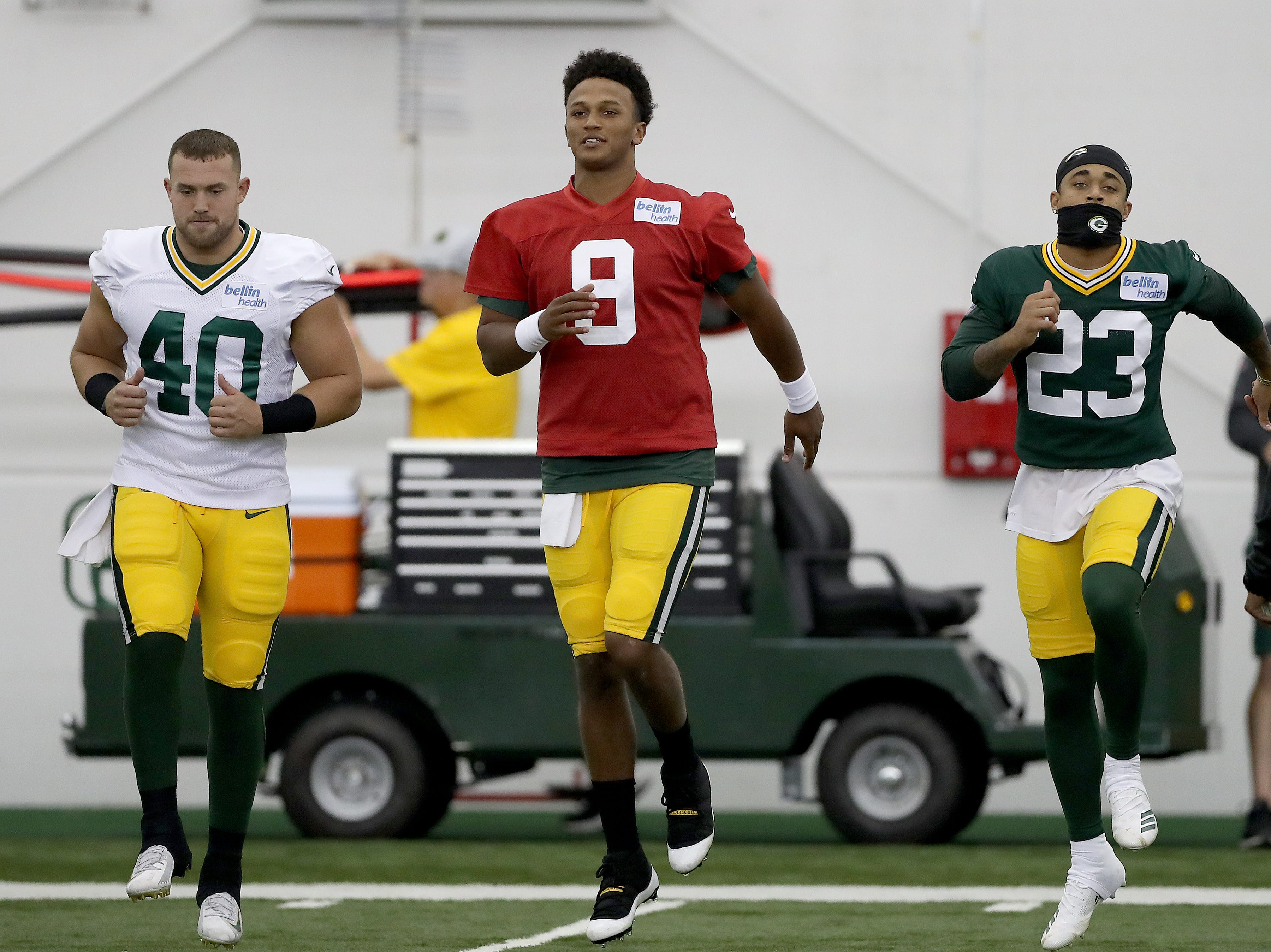 Green Bay Packers quarterback DeShone Kizer (9) along with cornerback Jaire Alexander (32) warm up during Packers practice in the Don Hutson Center Monday, September 3, 2018 in Ashwaubenon, Wis