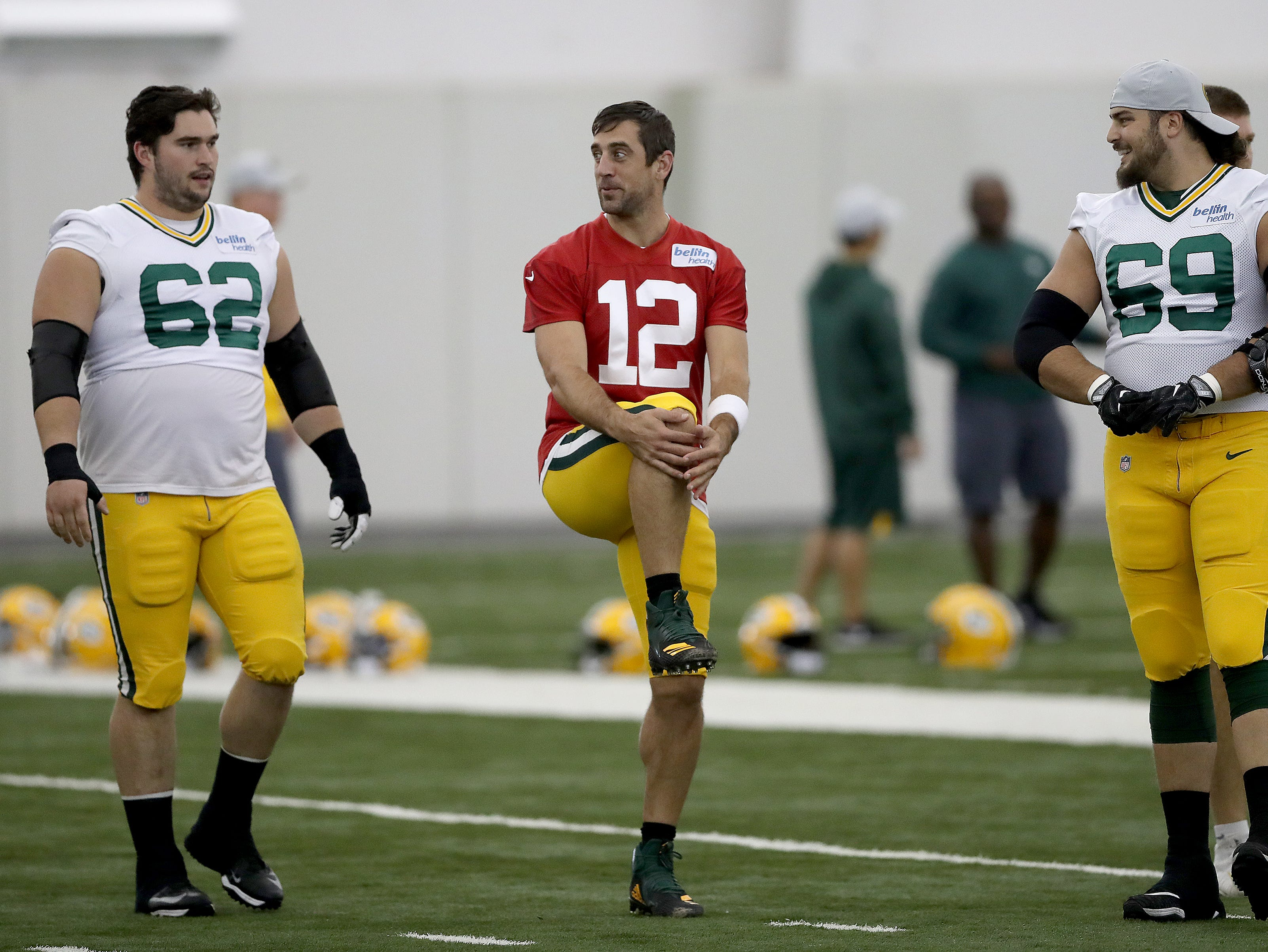 Green Bay Packers offensive guard Lucas Patrick (62), quarterback Aaron Rodgers (12) and offensive tackle David Bakhtiari (69) during Packers practice in the Don Hutson Center Monday, September 3, 2018 in Ashwaubenon, Wis