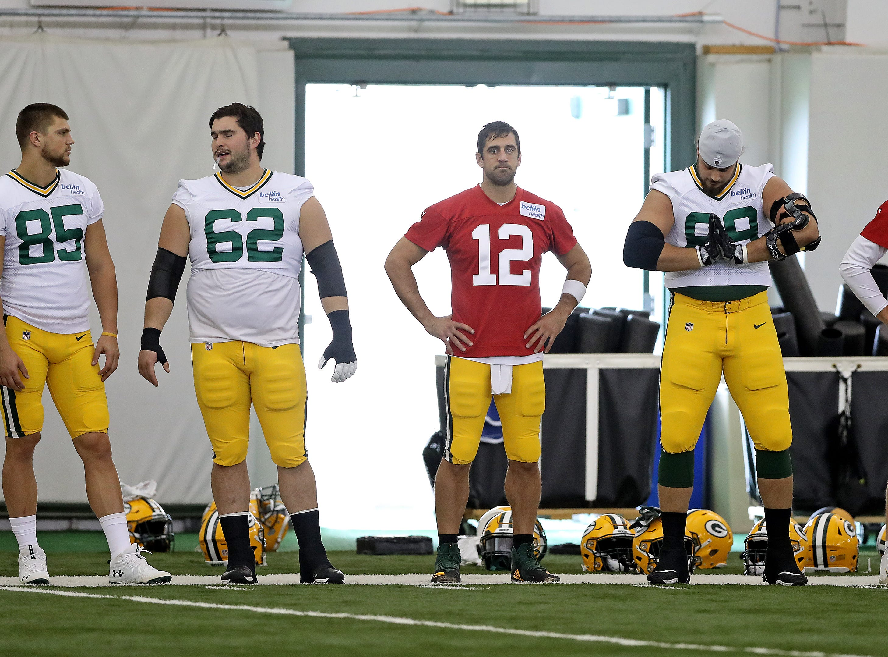 Green Bay Packers wide receiver Robert Tonyan (85), offensive guard Lucas Patrick (62), quarterback Aaron Rodgers (12), offensive tackle David Bakhtiari (69) an quarterback Tim Boyle (8) get ready for Packers practice in the Don Hutson Center Monday, September 3, 2018 in Ashwaubenon, Wis