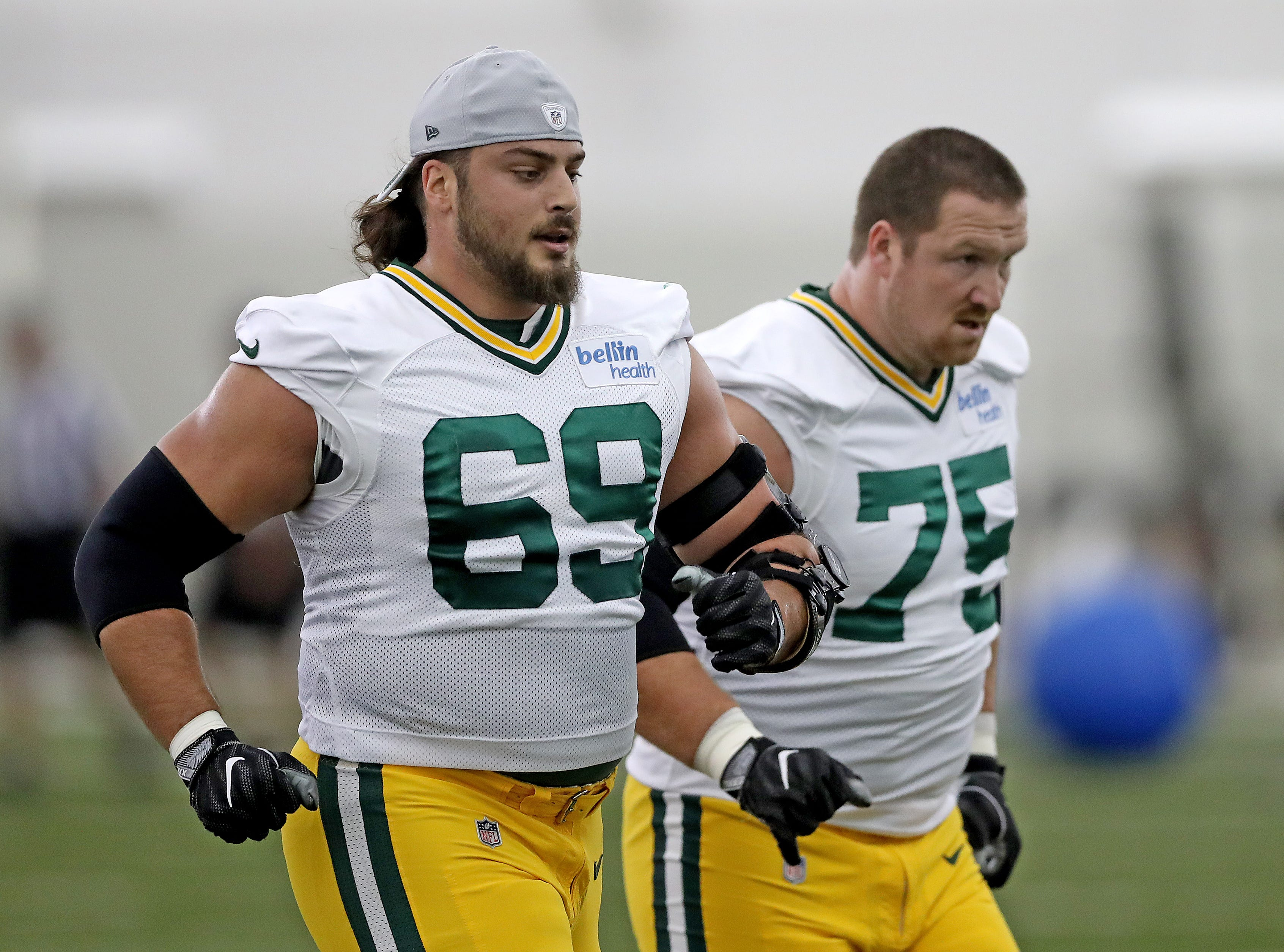Green Bay Packers offensive tackle David Bakhtiari (69) runs with offensive tackle Bryan Bulaga (75) during Packers practice in the Don Hutson Center Monday, September 3, 2018 in Ashwaubenon, Wis