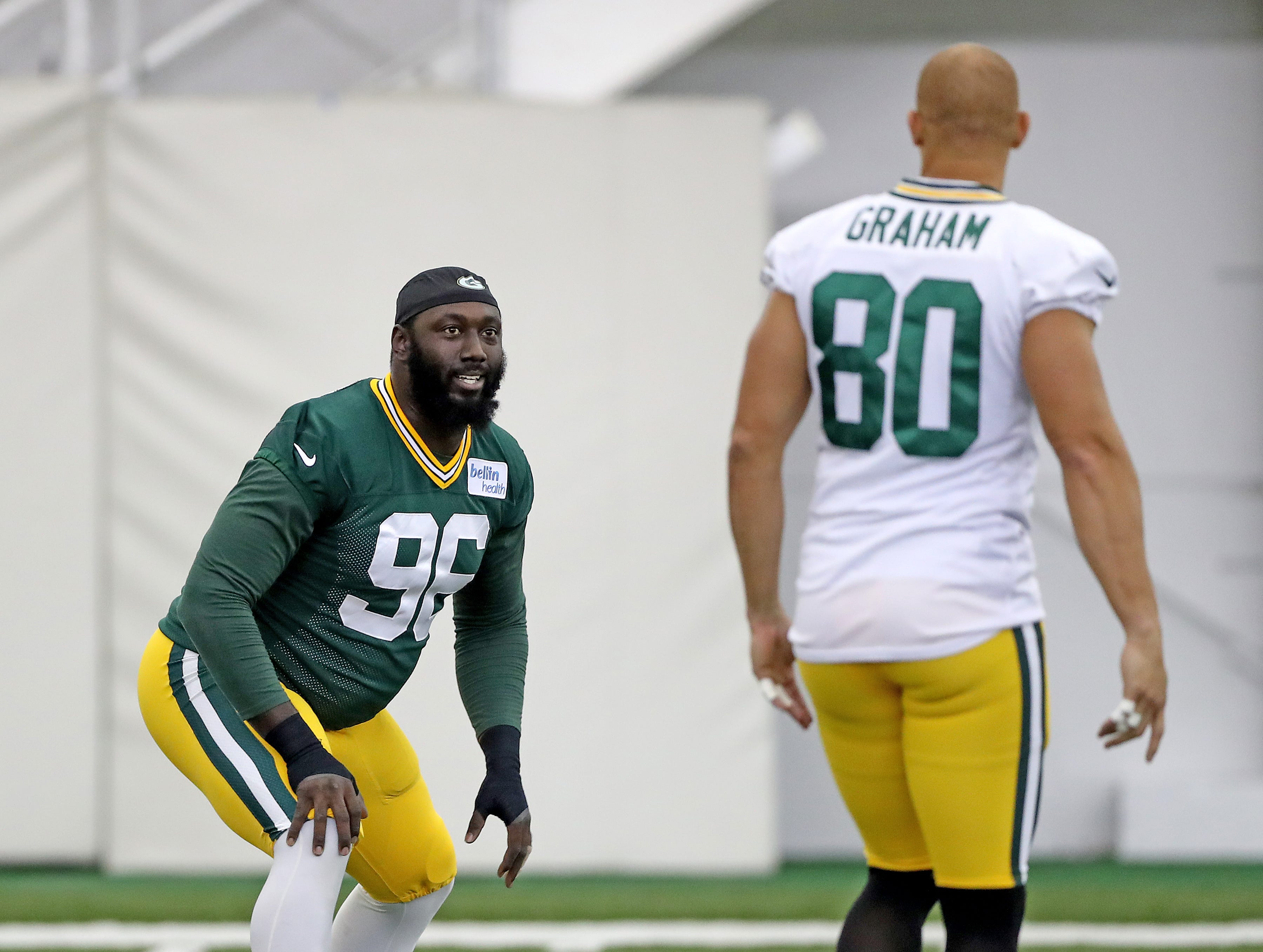 Green Bay Packers defensive end Muhammad Wilkerson (96) talks with tight end Jimmy Graham (80) during Packers practice in the Don Hutson Center Monday, September 3, 2018 in Ashwaubenon, Wis