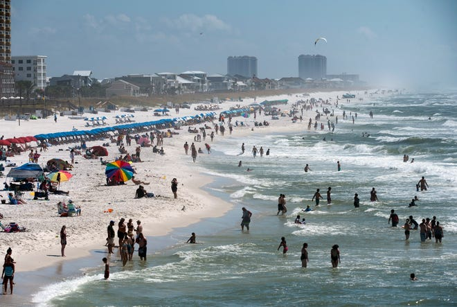 Visitors and locals enjoy the sun, sand, and surf at Pensacola Beach this Labor Day, Sept. 3, 2018.