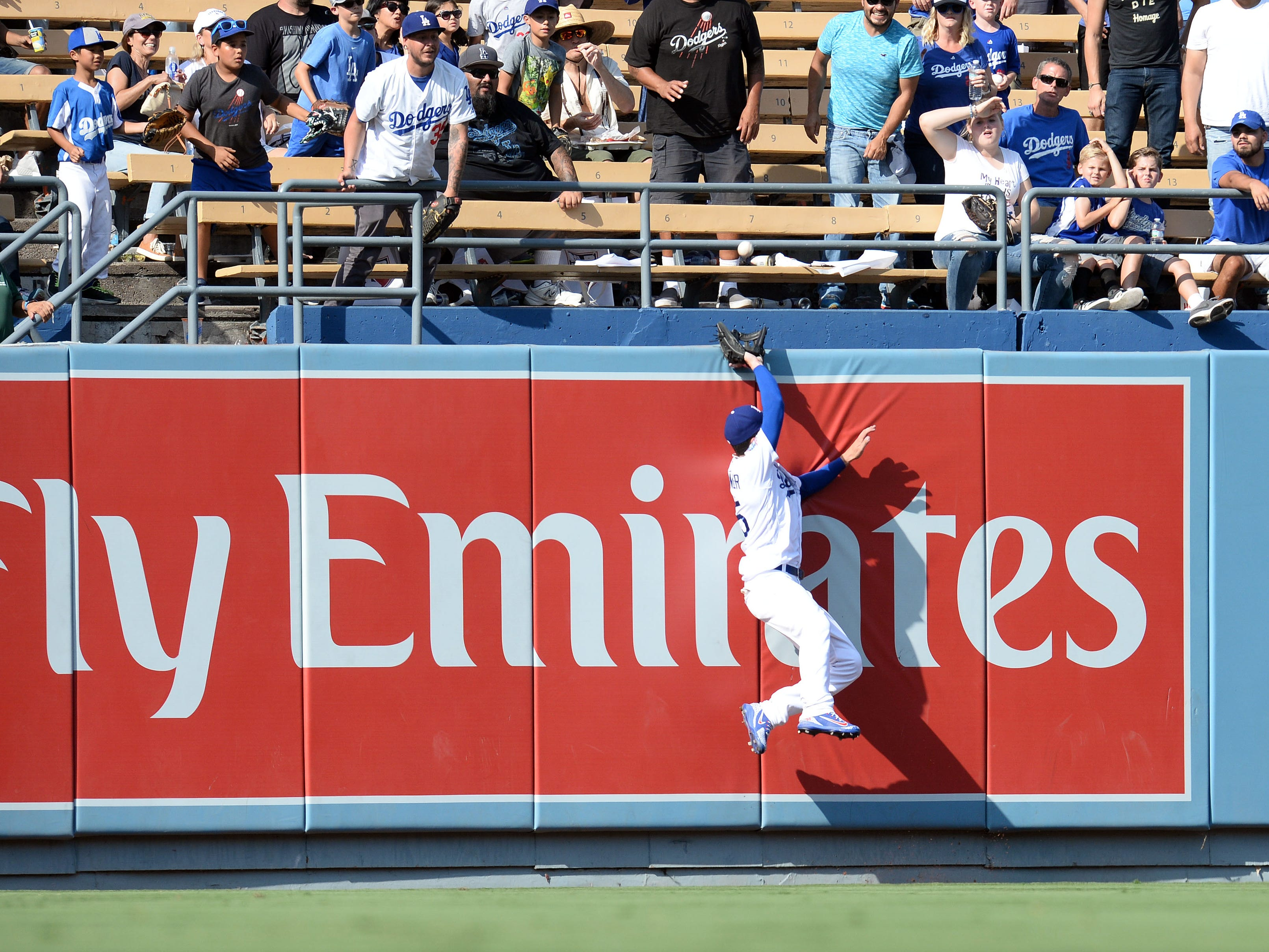 September 2, 2018; Los Angeles, CA, USA; Los Angeles Dodgers center fielder Cody Bellinger (35) misses catching the home run hit by Arizona Diamondbacks second baseman Daniel Descalso (3) in the ninth inning at Dodger Stadium. Mandatory Credit: Gary A. Vasquez-USA TODAY Sports