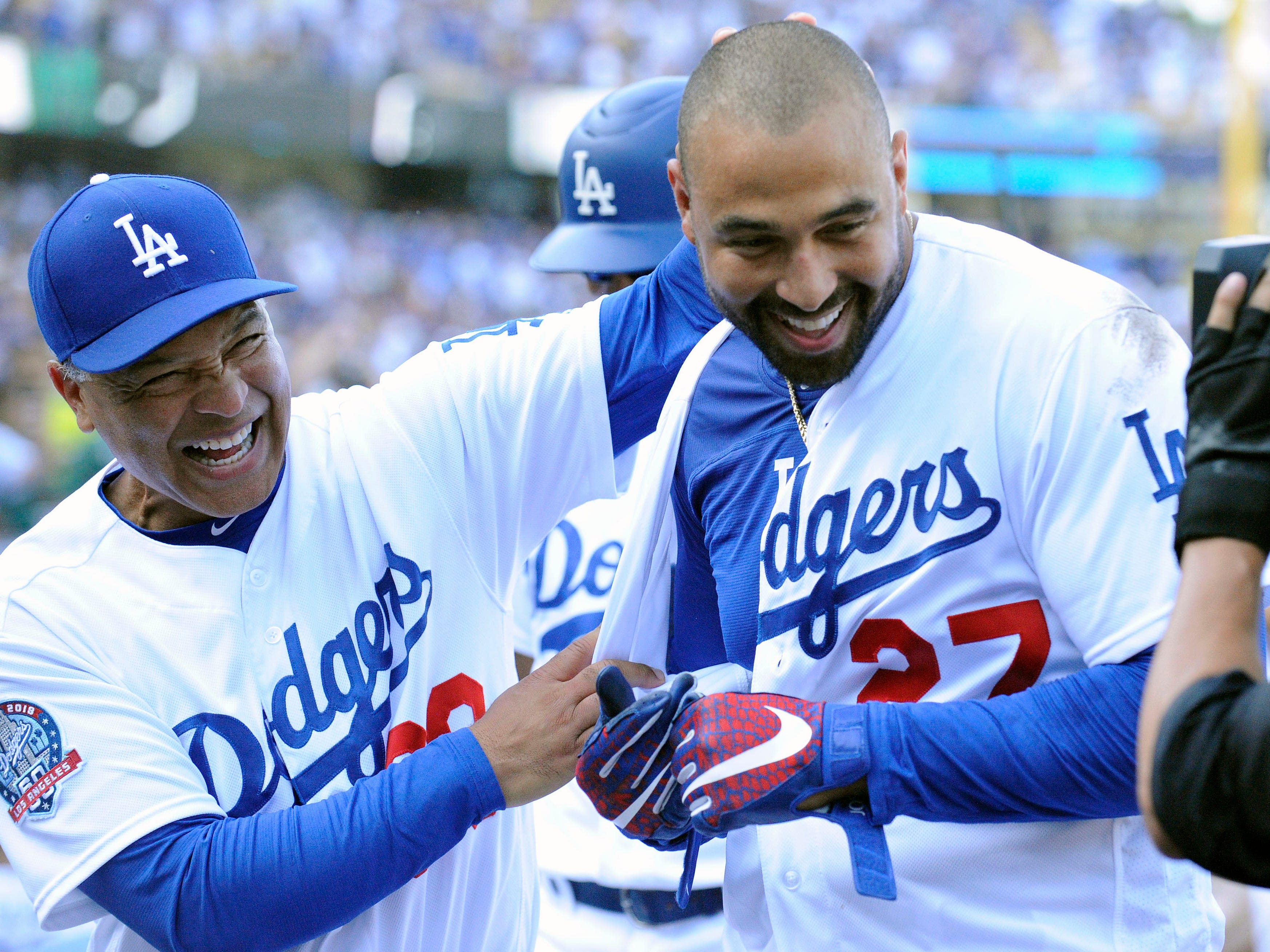 September 2, 2018; Los Angeles, CA, USA; Los Angeles Dodgers left fielder Matt Kemp (27) celebrates with manager Dave Roberts (30) after hitting a two run RBI walk off double against the Arizona Diamondbacks in the ninth inning at Dodger Stadium. Mandatory Credit: Gary A. Vasquez-USA TODAY Sports