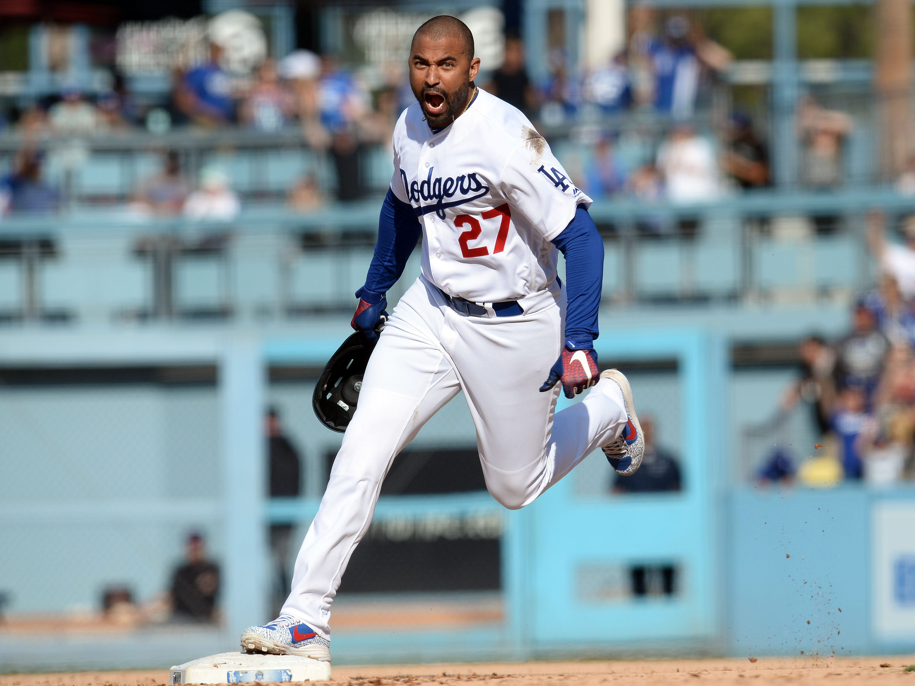 September 2, 2018; Los Angeles, CA, USA; Los Angeles Dodgers left fielder Matt Kemp (27) reacts after hitting a two run RBI walk off double against the Arizona Diamondbacks in the ninth inning at Dodger Stadium. Mandatory Credit: Gary A. Vasquez-USA TODAY Sports