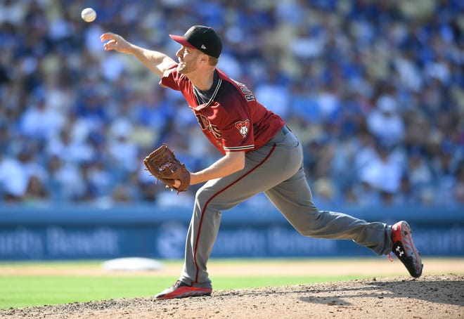 Brad Boxberger #31 of the Arizona Diamondbacks pitches in the nineth inning against the Los Angeles Dodgers at Dodger Stadium on September 2, 2018 in Los Angeles, California.