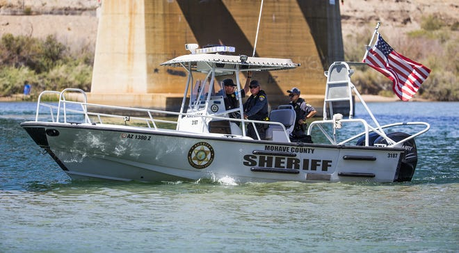 Mohave County Sheriff's Department deputies head down the Colorado River about 1/2 mile south of the Topoc Marina searching for three people still missing from a boat collision Saturday night about 30 miles north of Lake Havasu City.  Nine people were injured in the crash.
