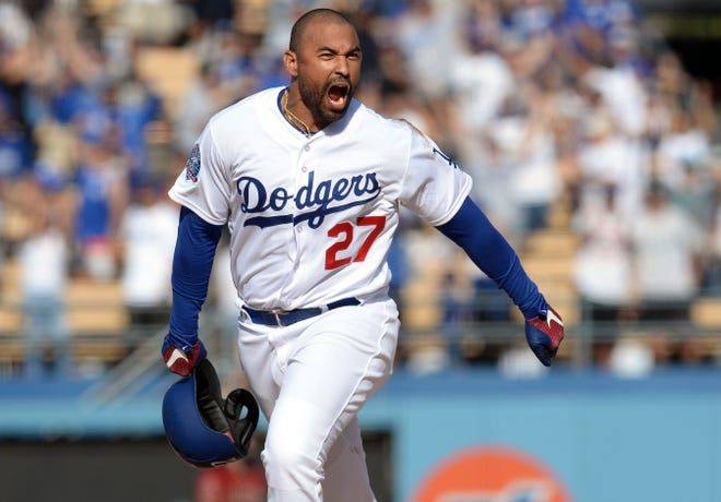 Los Angeles Dodgers left fielder Matt Kemp (27) reacts after hitting a two run RBI walk off double against the Arizona Diamondbacks in the ninth inning at Dodger Stadium.