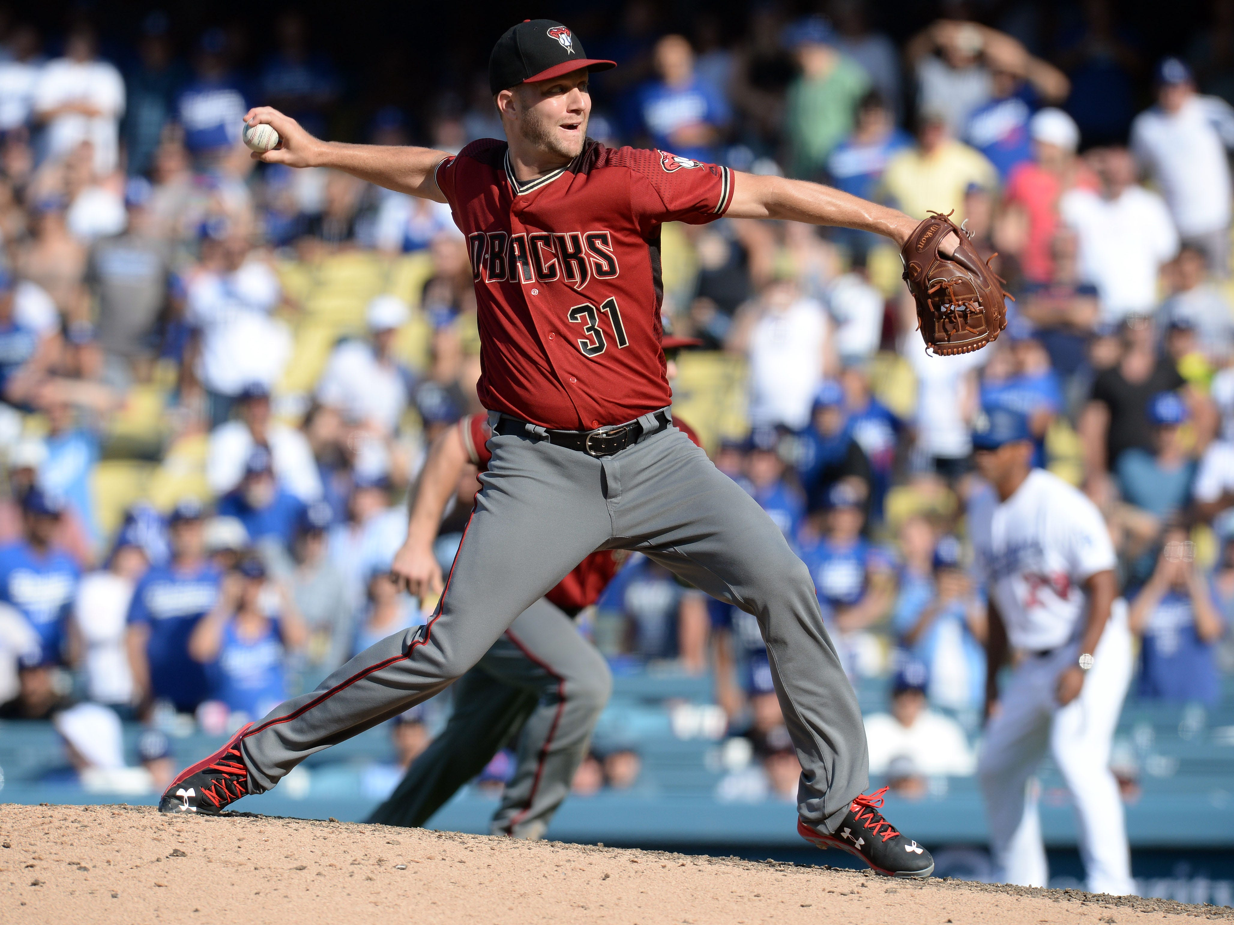 September 2, 2018; Los Angeles, CA, USA; Arizona Diamondbacks relief pitcher Brad Boxberger (31) throws against the Los Angeles Dodgers in the ninth inning at Dodger Stadium. Mandatory Credit: Gary A. Vasquez-USA TODAY Sports
