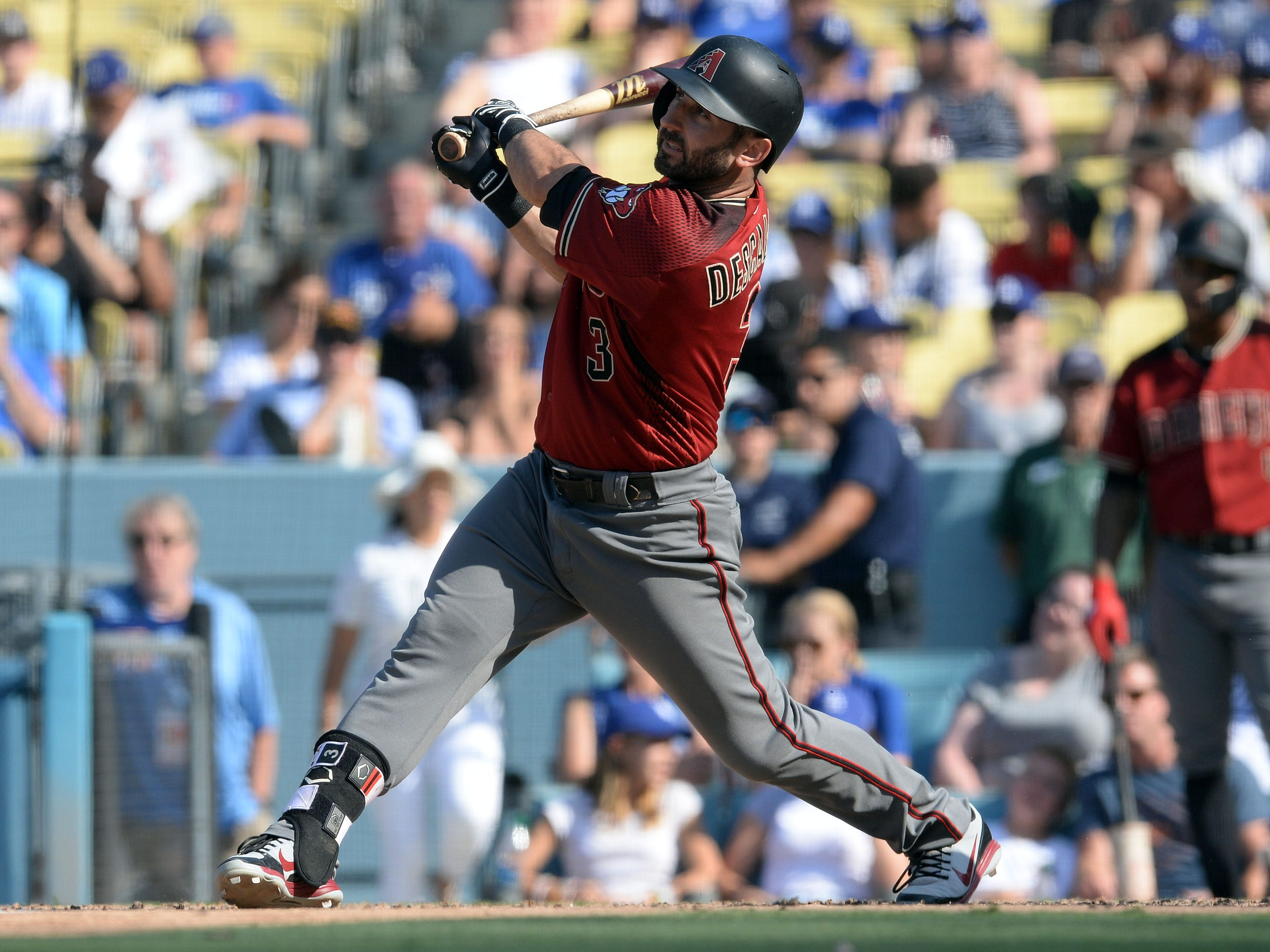 September 2, 2018; Los Angeles, CA, USA; Arizona Diamondbacks second baseman Daniel Descalso (3) hits a solo home run against the Los Angeles Dodgers in the ninth inning at Dodger Stadium. Mandatory Credit: Gary A. Vasquez-USA TODAY Sports