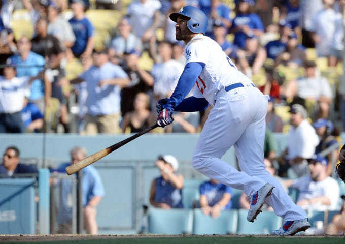 September 2, 2018; Los Angeles, CA, USA; Los Angeles Dodgers left fielder Matt Kemp (27) hits a two run RBI walk off double against the Arizona Diamondbacks in the ninth inning at Dodger Stadium. Mandatory Credit: Gary A. Vasquez-USA TODAY Sports