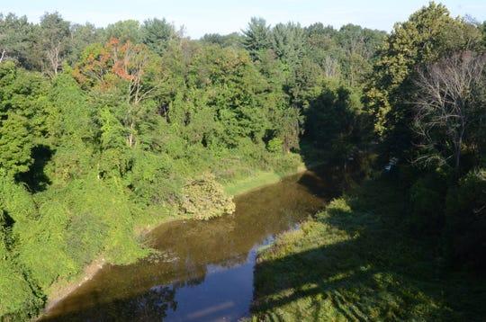 Mill Creek runs beneath the trestle bridge connecting the Wadhams to Avoca Trail on Sept. 3, 2018, in Avoca, Michigan.