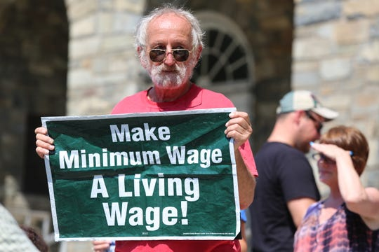 Joseph Barbarito holds a sign at the 24th annual Labor Day Rally in Poughkeepsie on Sept. 3, 2018.