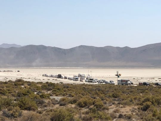 Vehicles line up Monday afternoon for the exodus out of the playa after Burning Man ended. The wait could take several hours to get past the gates and onto the highway.