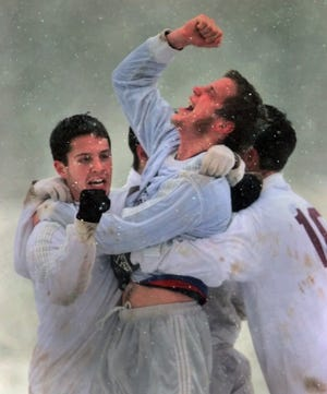 Pittsford Mendon's Keith Evans, center, celebrates with teammates Jeff Parrinello, left, and Tony Mendicino after the Vikings defeated Hauppauge  1-0 in sthe state semifinals on Nov. 14, 1997.